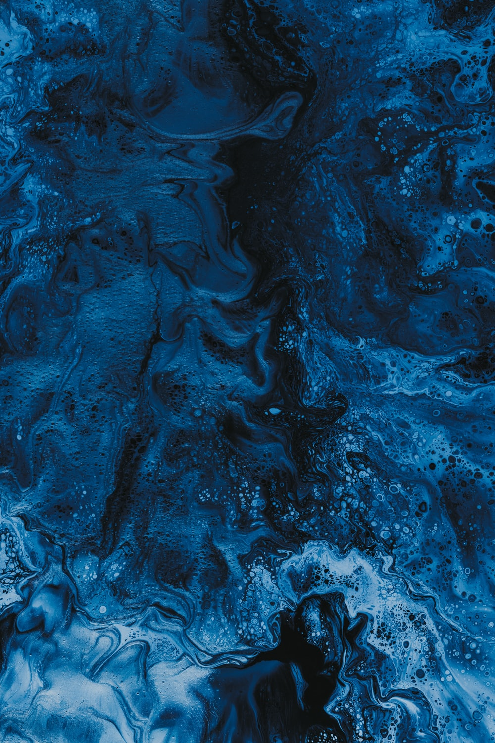 blue water with white bubbles