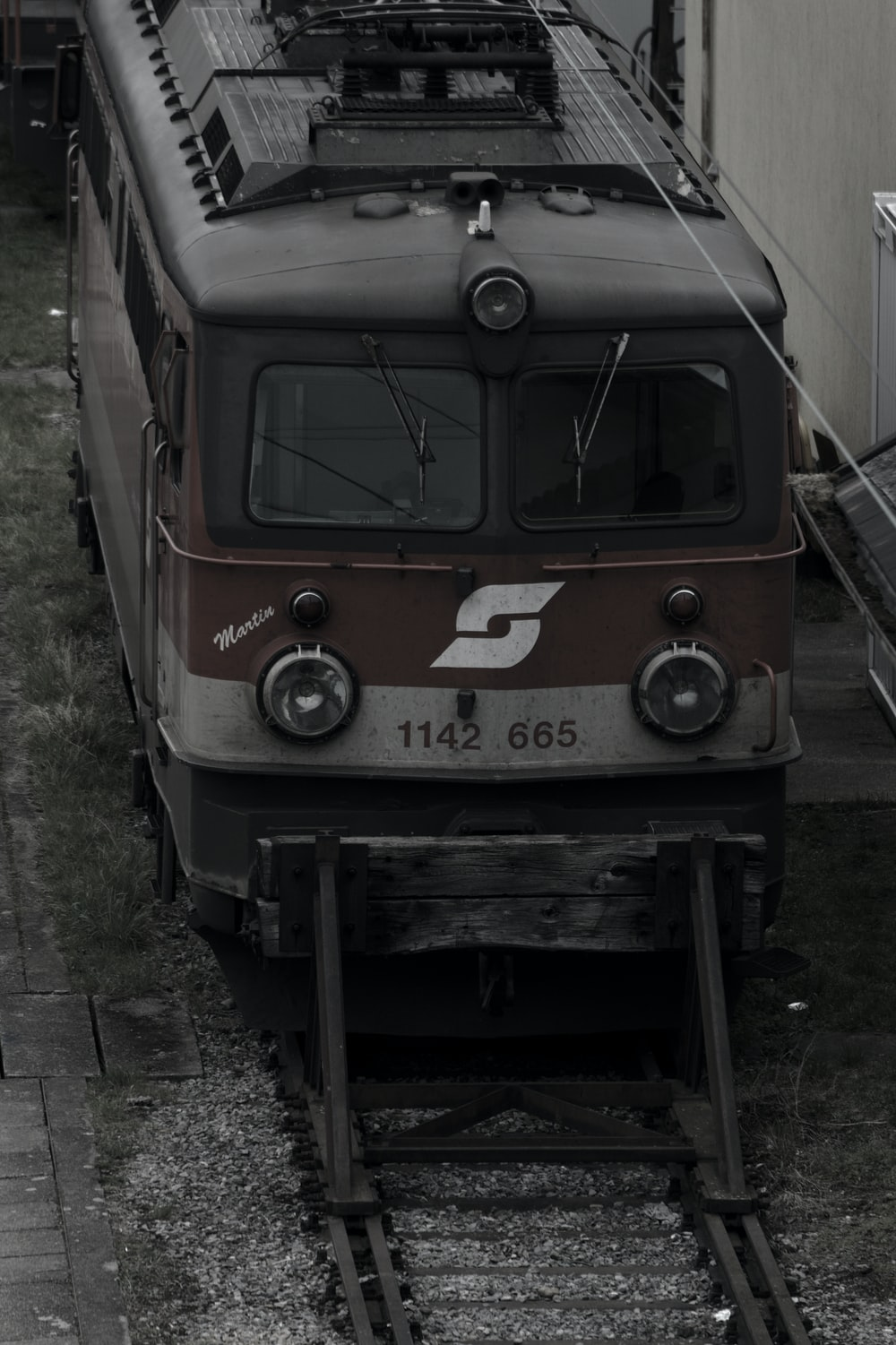 white and brown train on rail tracks during daytime