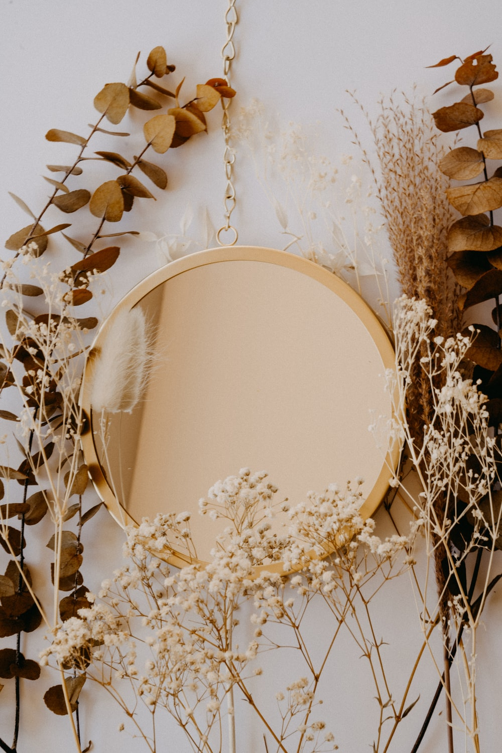 brown and white round mirror