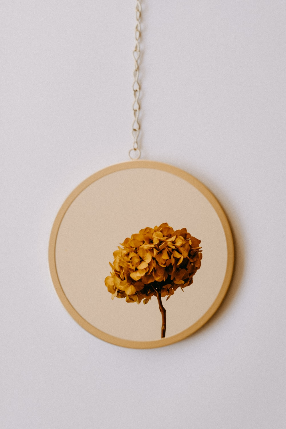 brown and white floral round hanging decor
