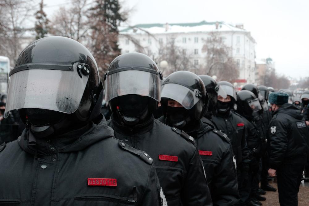 group of men wearing black helmet and black jacket