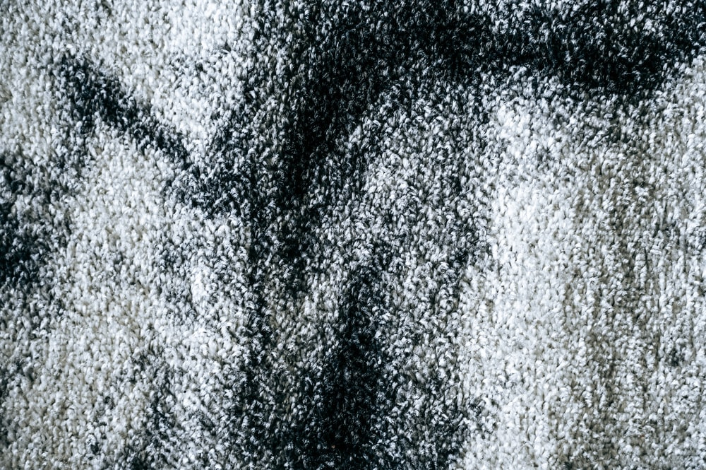 black textile in close up photography