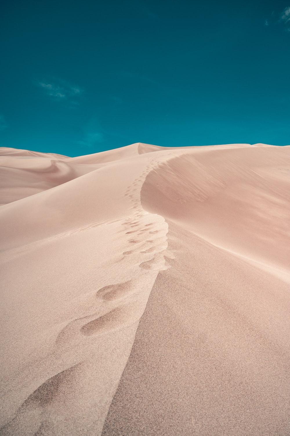 white sand under blue sky during daytime