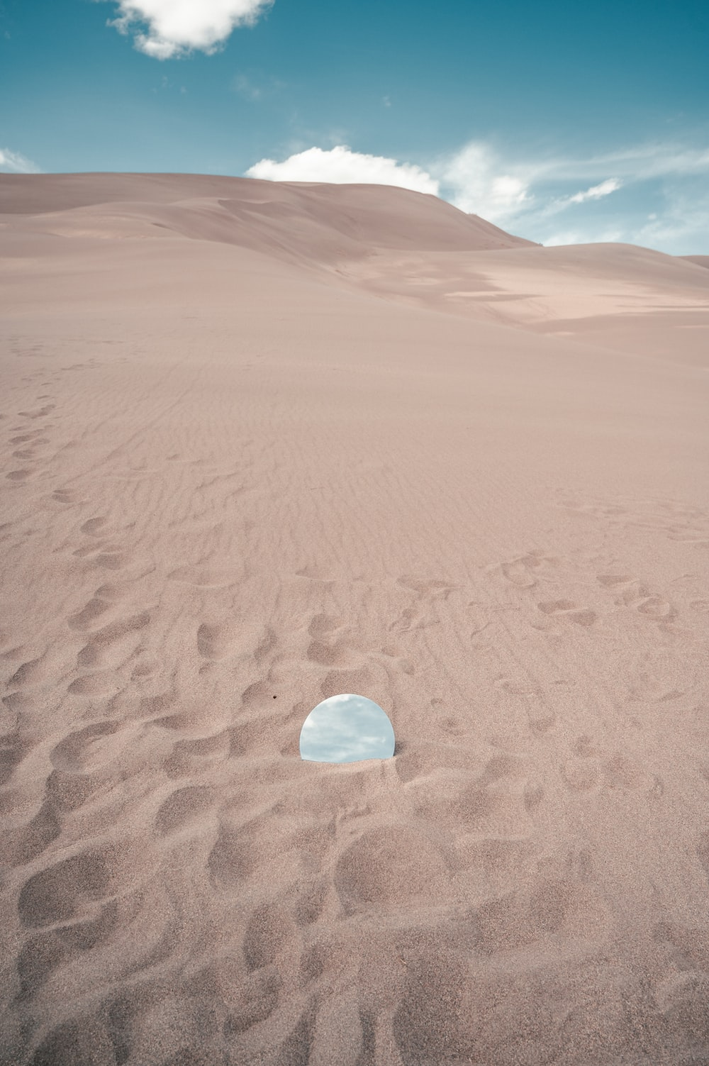 clear glass ball on brown sand