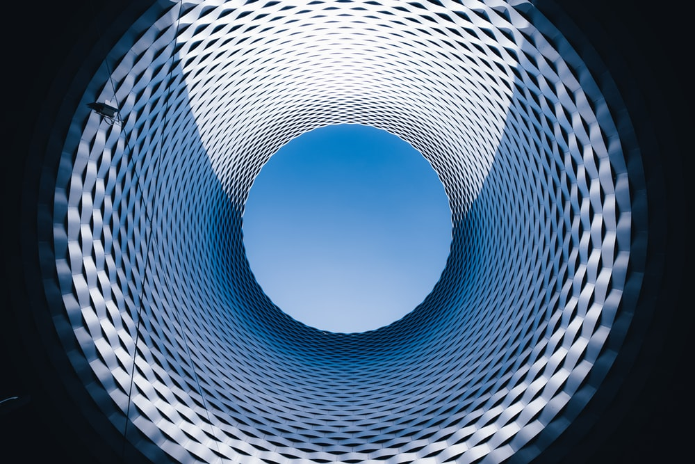 blue and white spiral tunnel