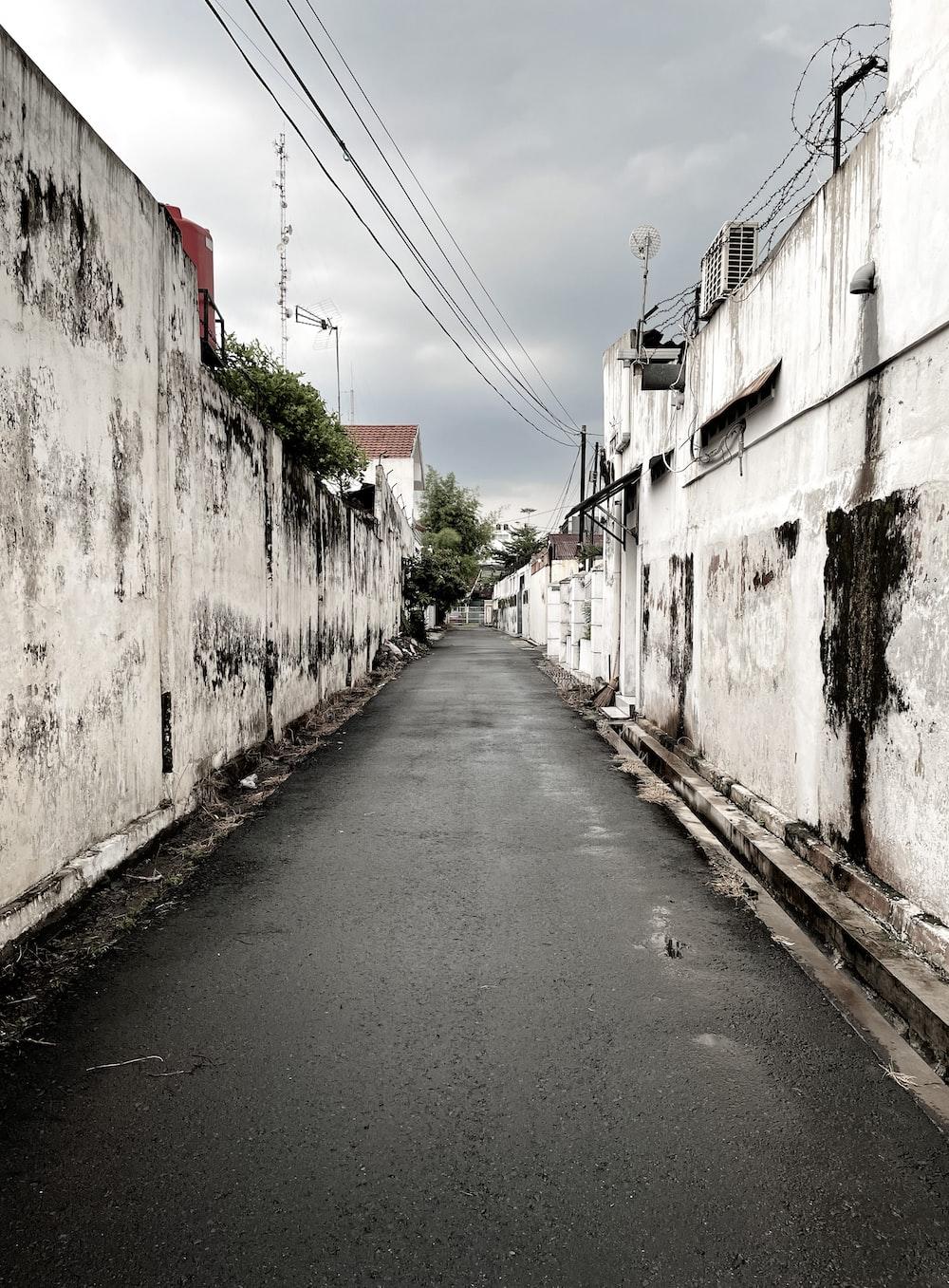 empty road in between concrete buildings