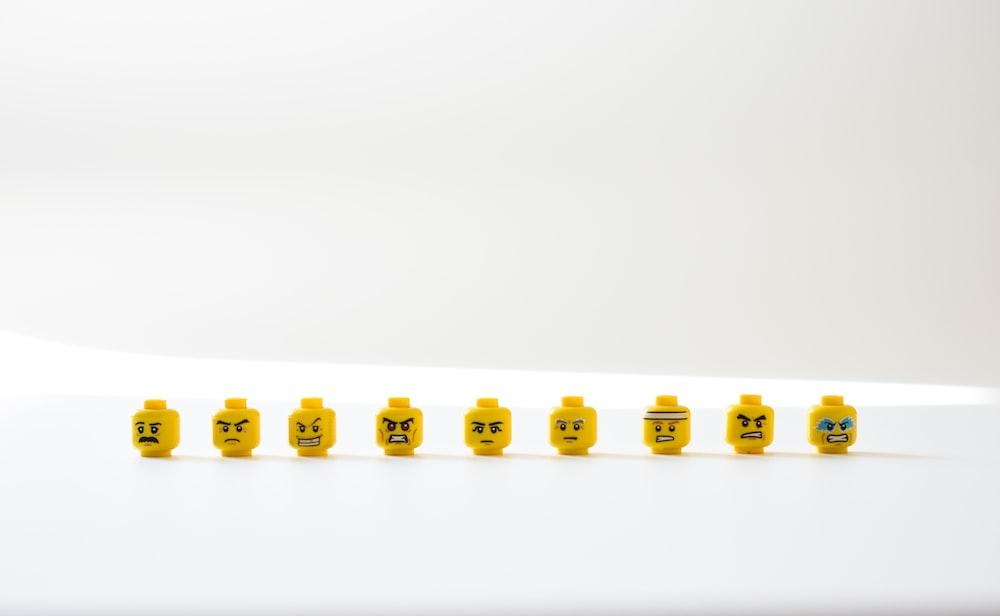 yellow and white round plastic toy