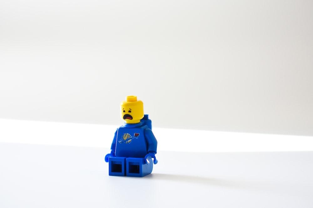 blue lego minifig on white surface