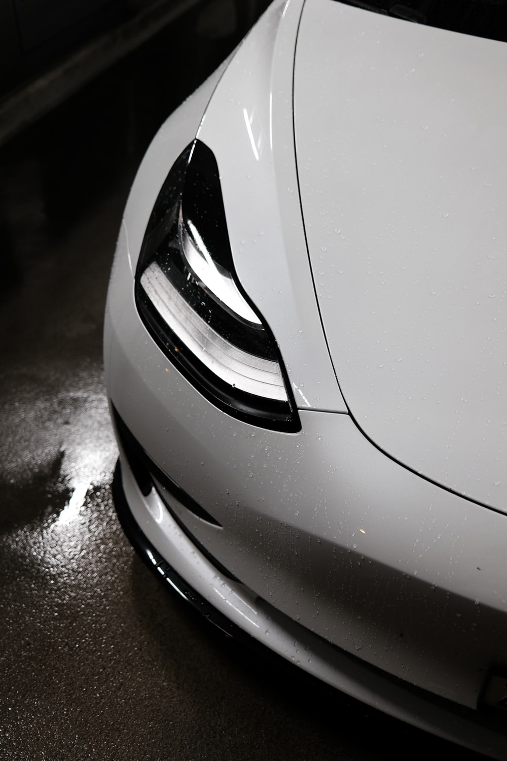 white and black car in grayscale photography