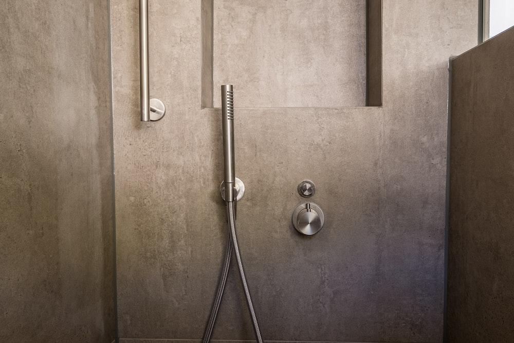 stainless steel door knob on brown wooden door