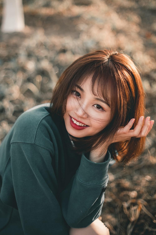 smiling girl in gray long sleeve shirt