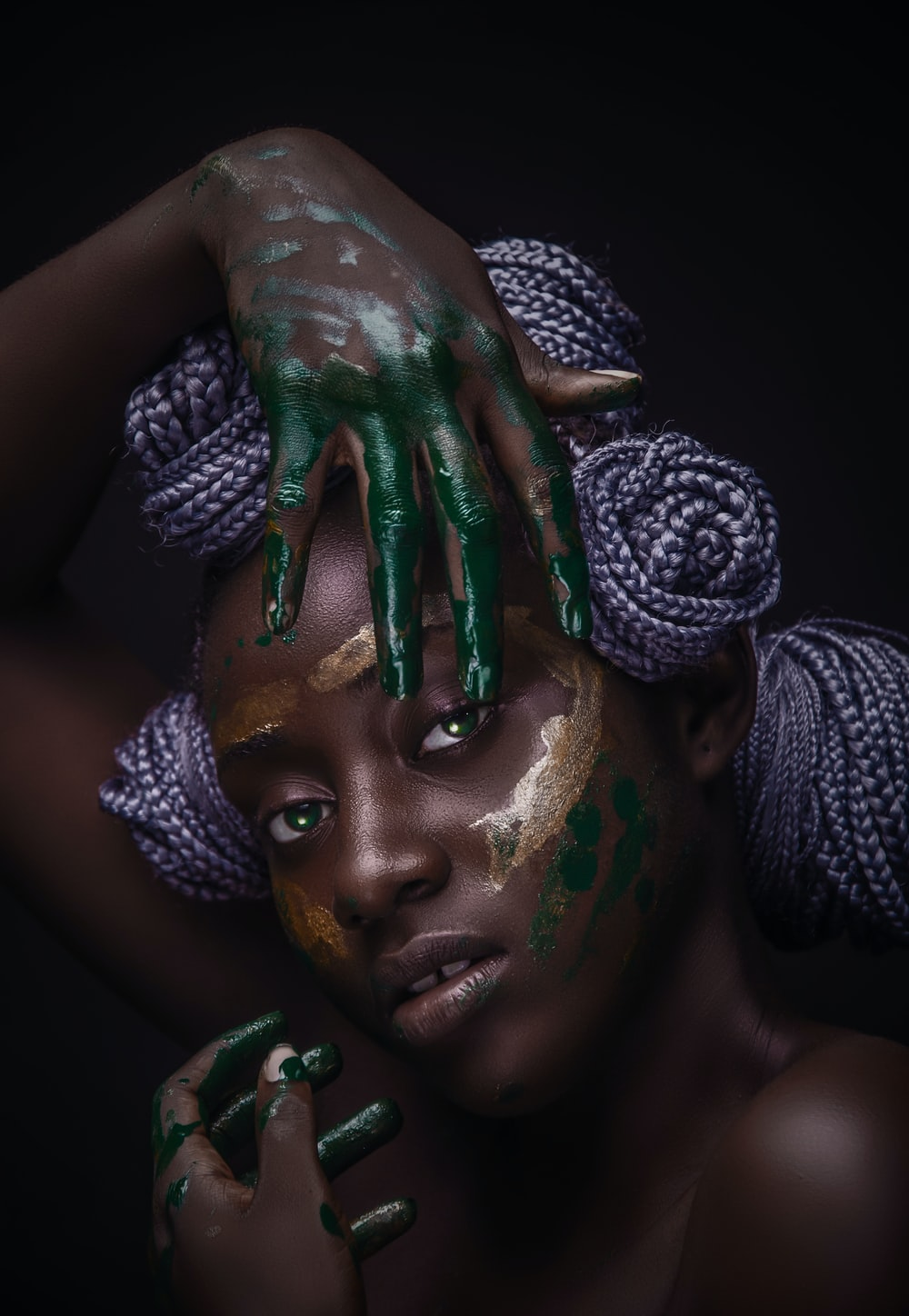 woman with green and white paint on face