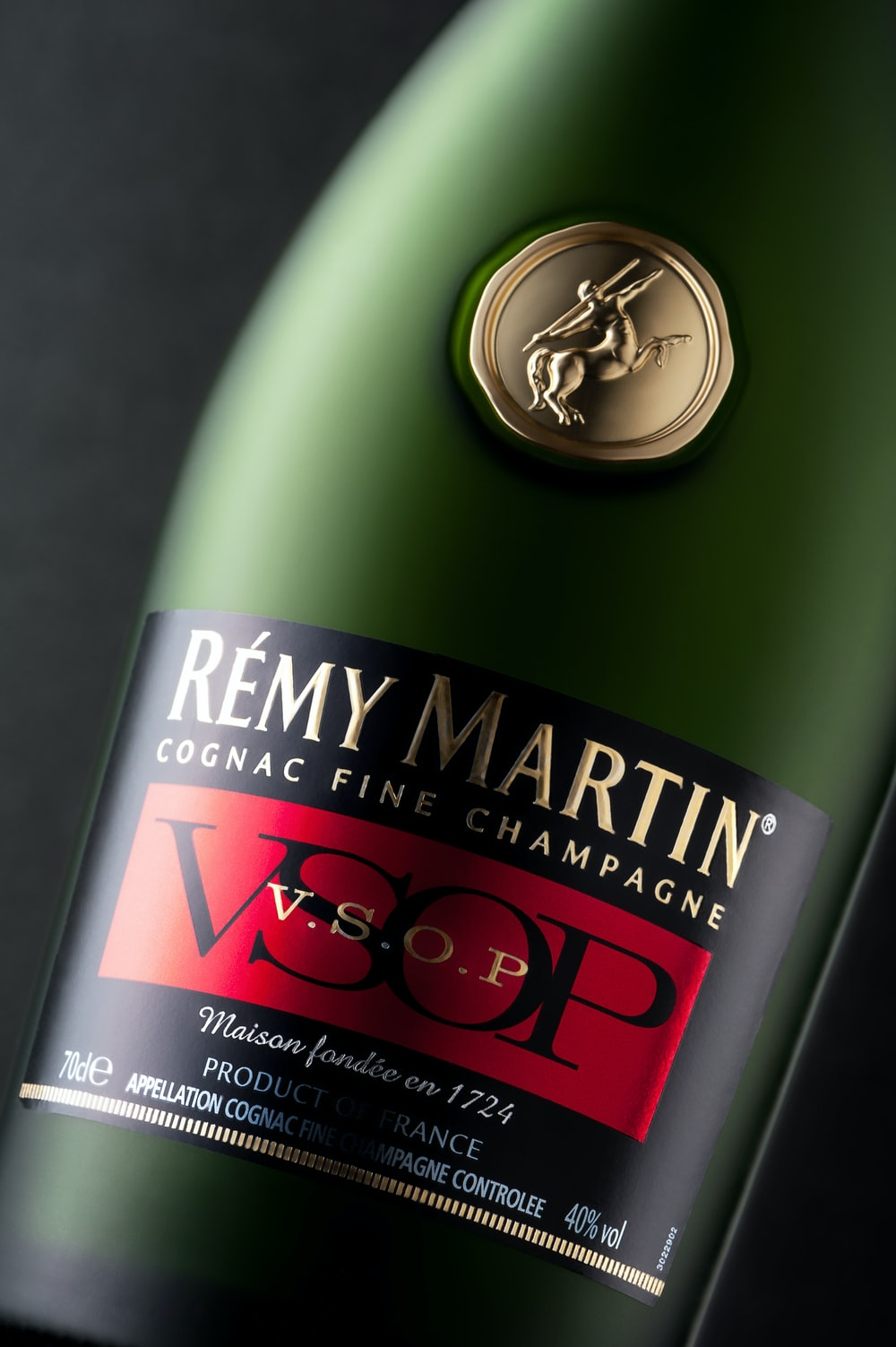 green and black labeled bottle