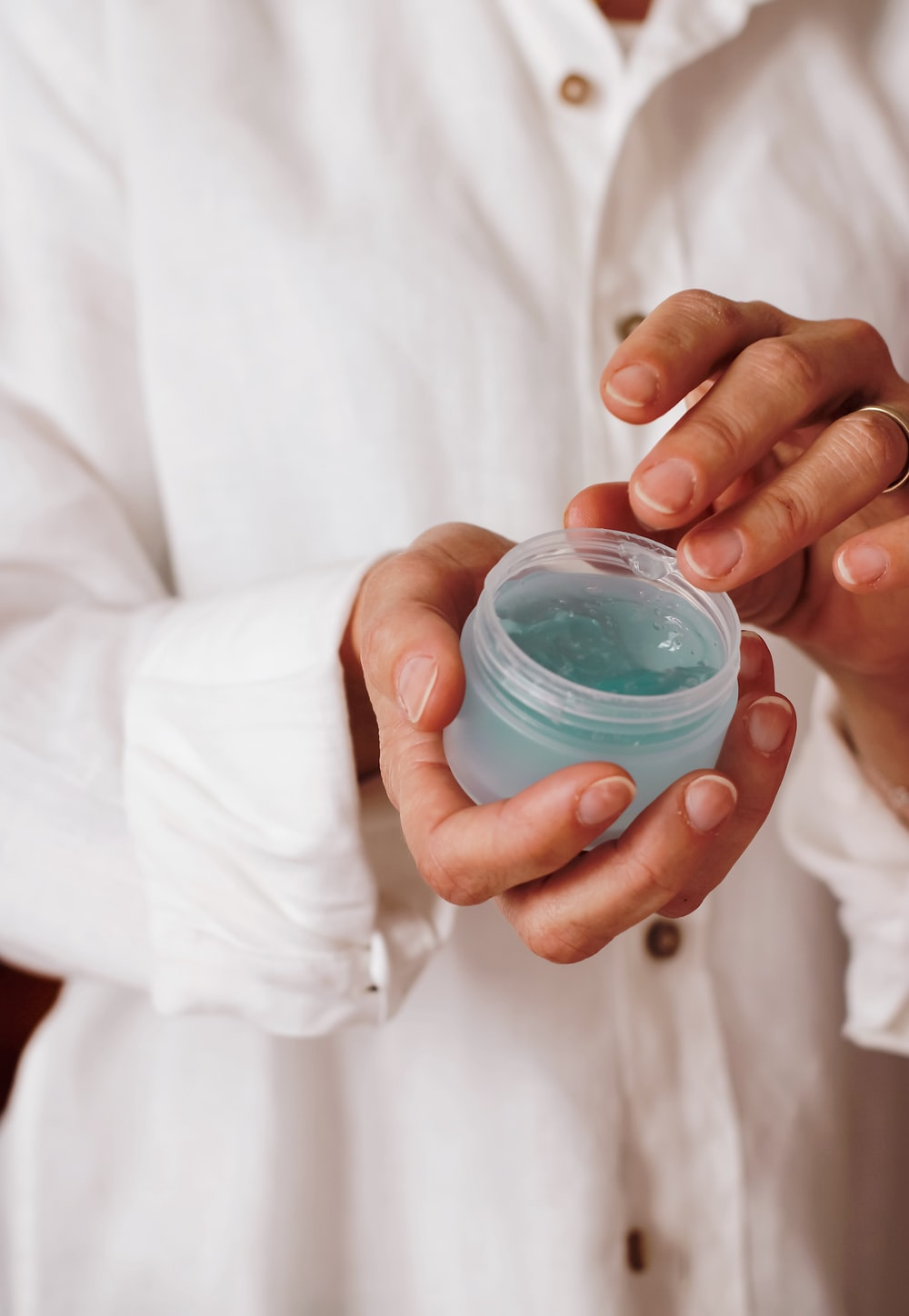 person holding blue plastic container
