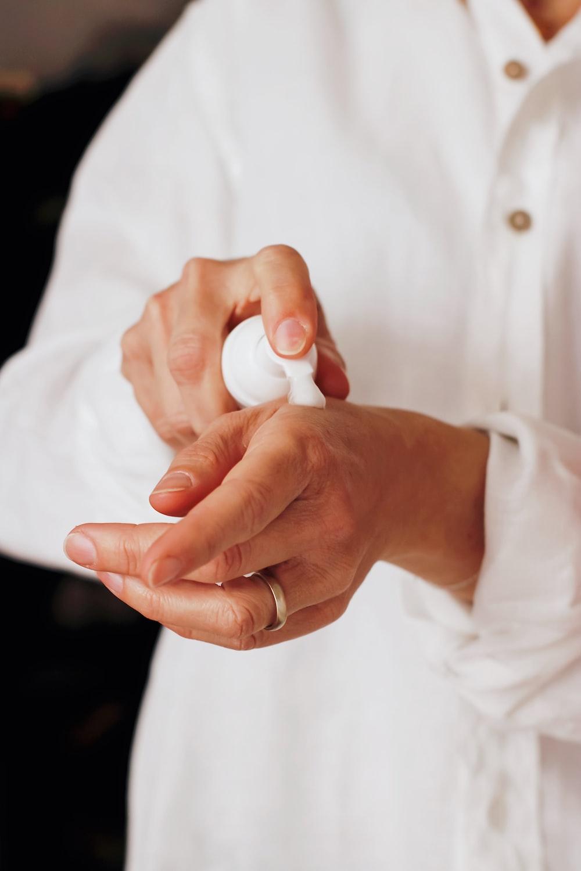 person holding white round ornament