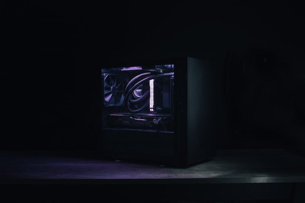 black and silver speaker on black table