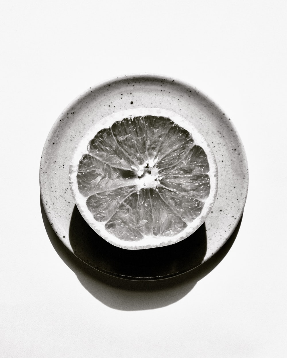 sliced lemon in white ceramic bowl