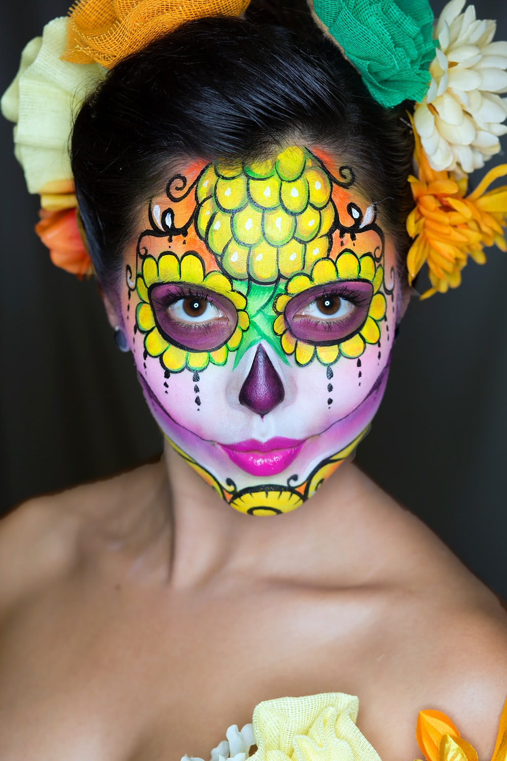 woman with yellow and purple face paint