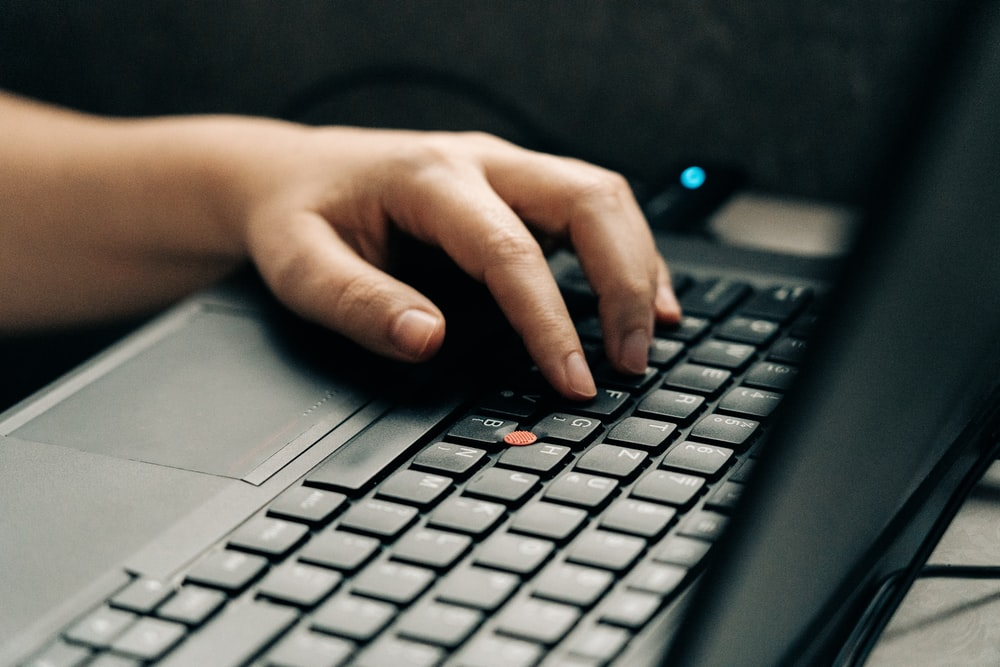 person using black and gray laptop computer