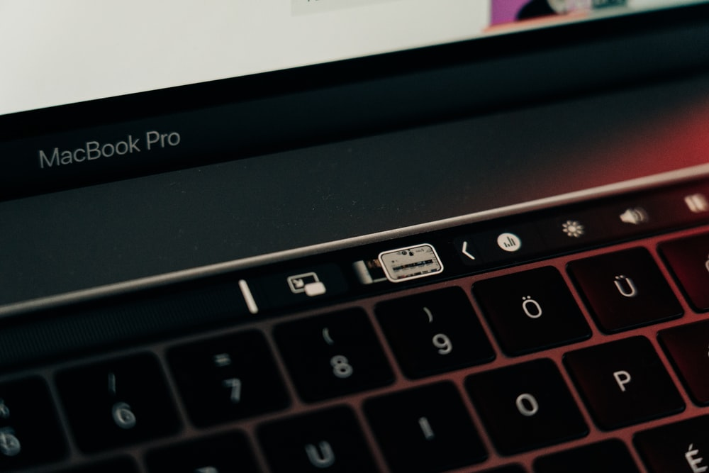 black and silver macbook pro