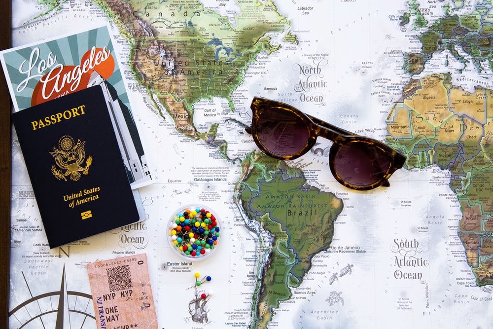 brown framed sunglasses on map