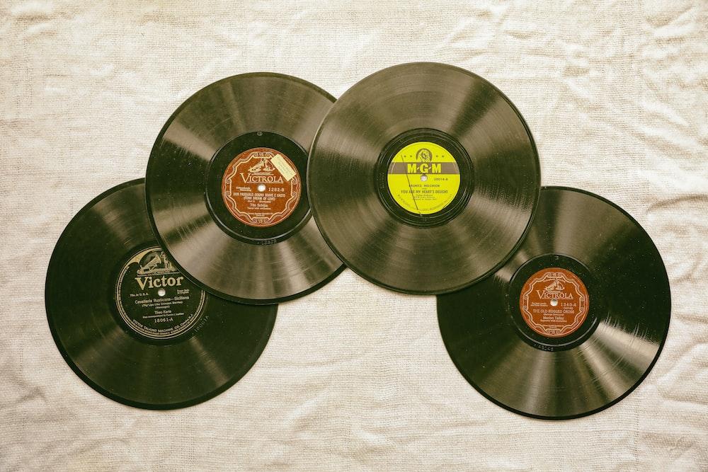 black vinyl record on white textile