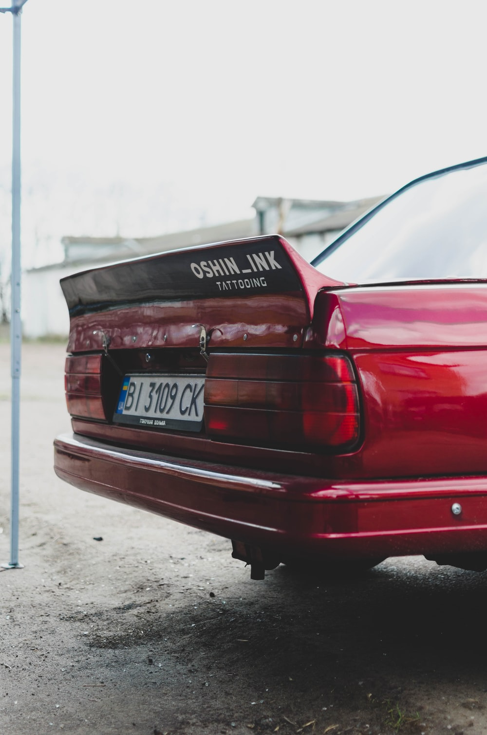 red car on gray concrete floor