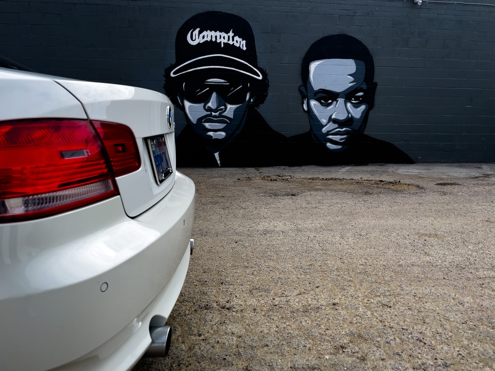white car beside black and white wall