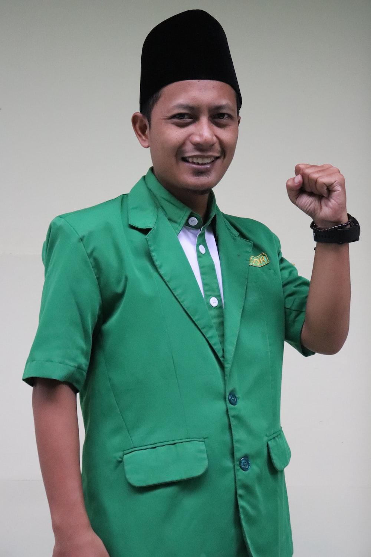 man in green button up shirt
