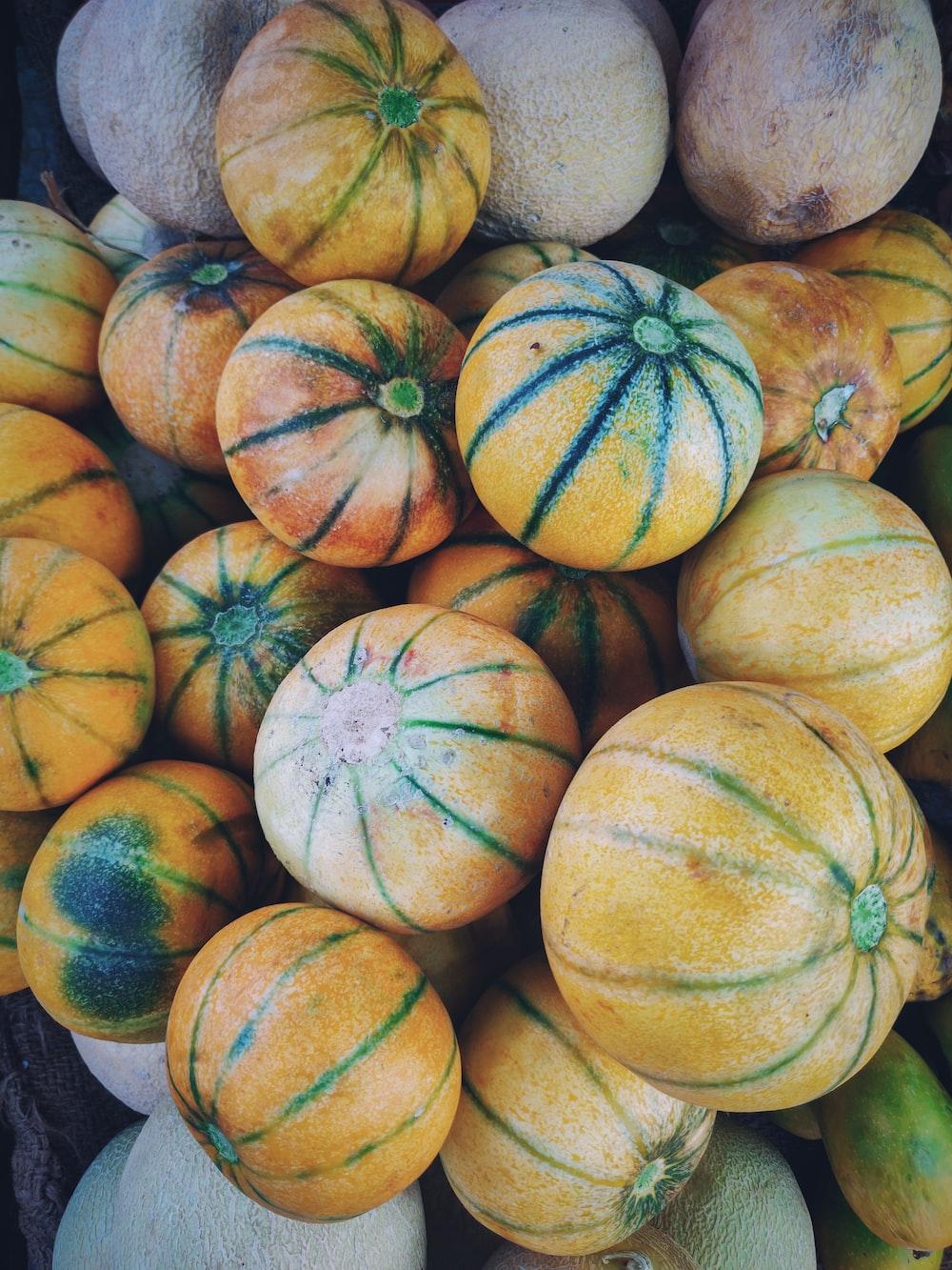 yellow and orange round fruits