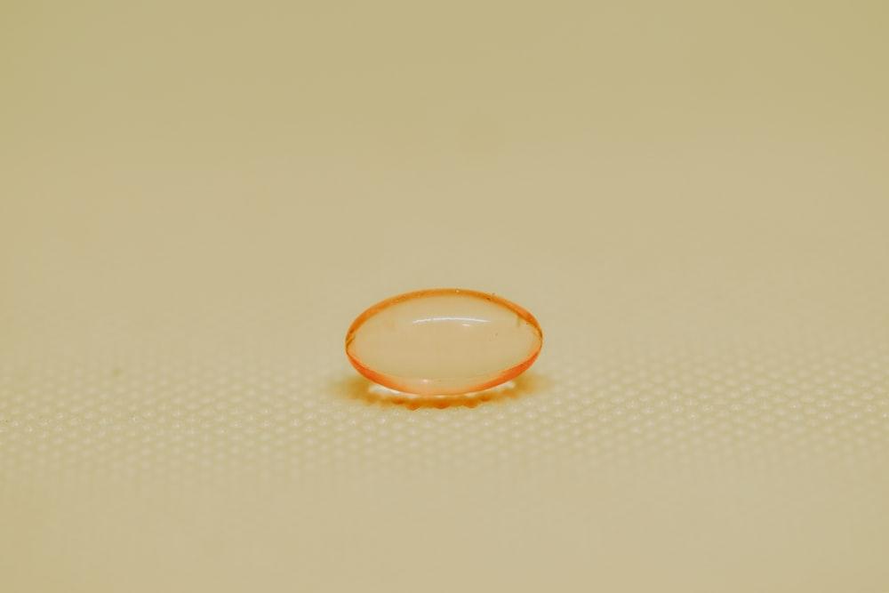 orange and white round ring