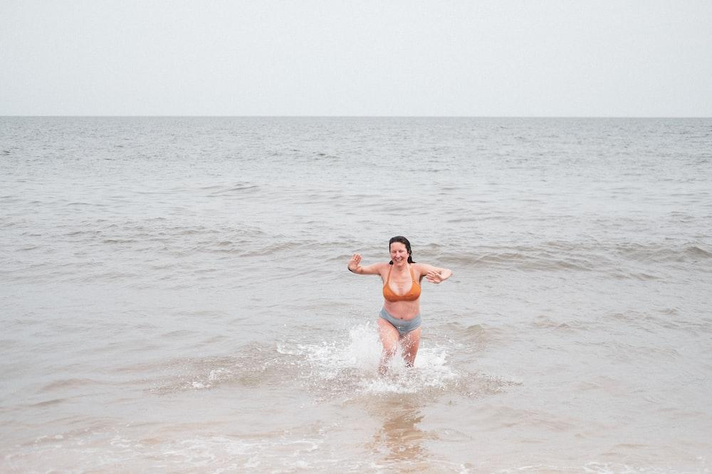 woman in blue bikini on beach during daytime