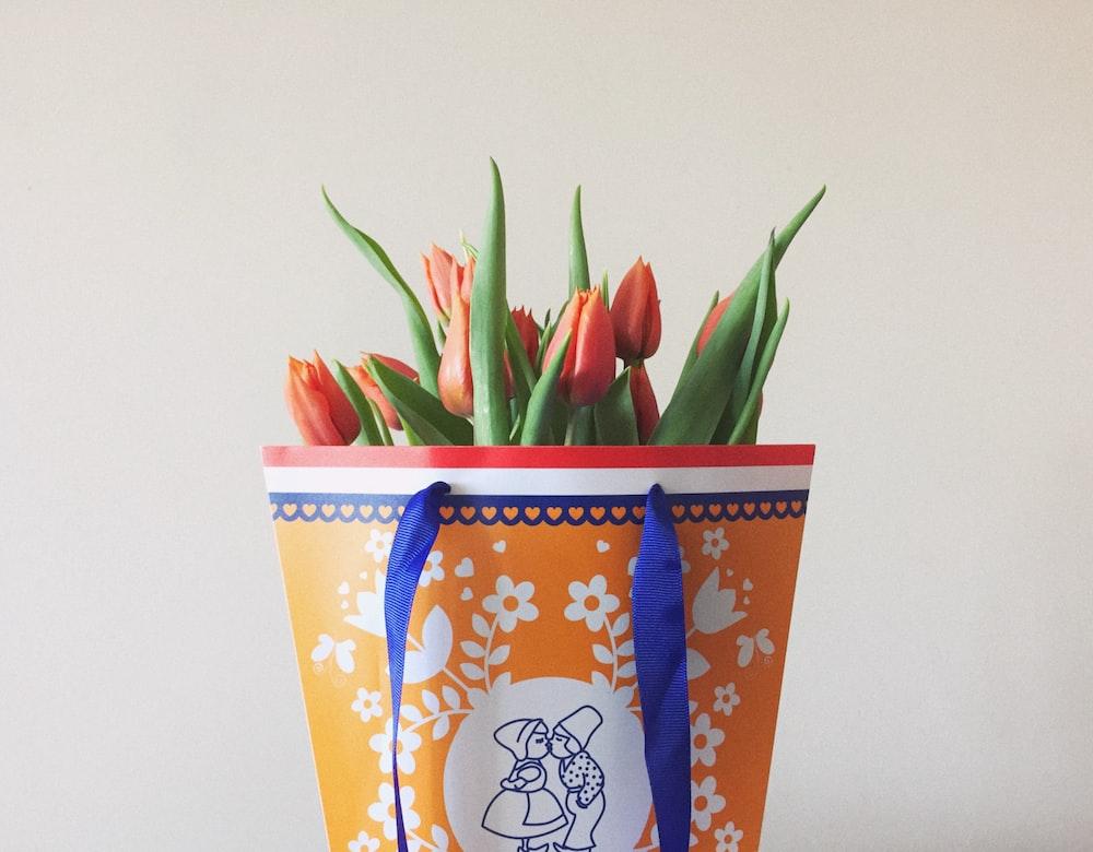 orange and white floral paper bag