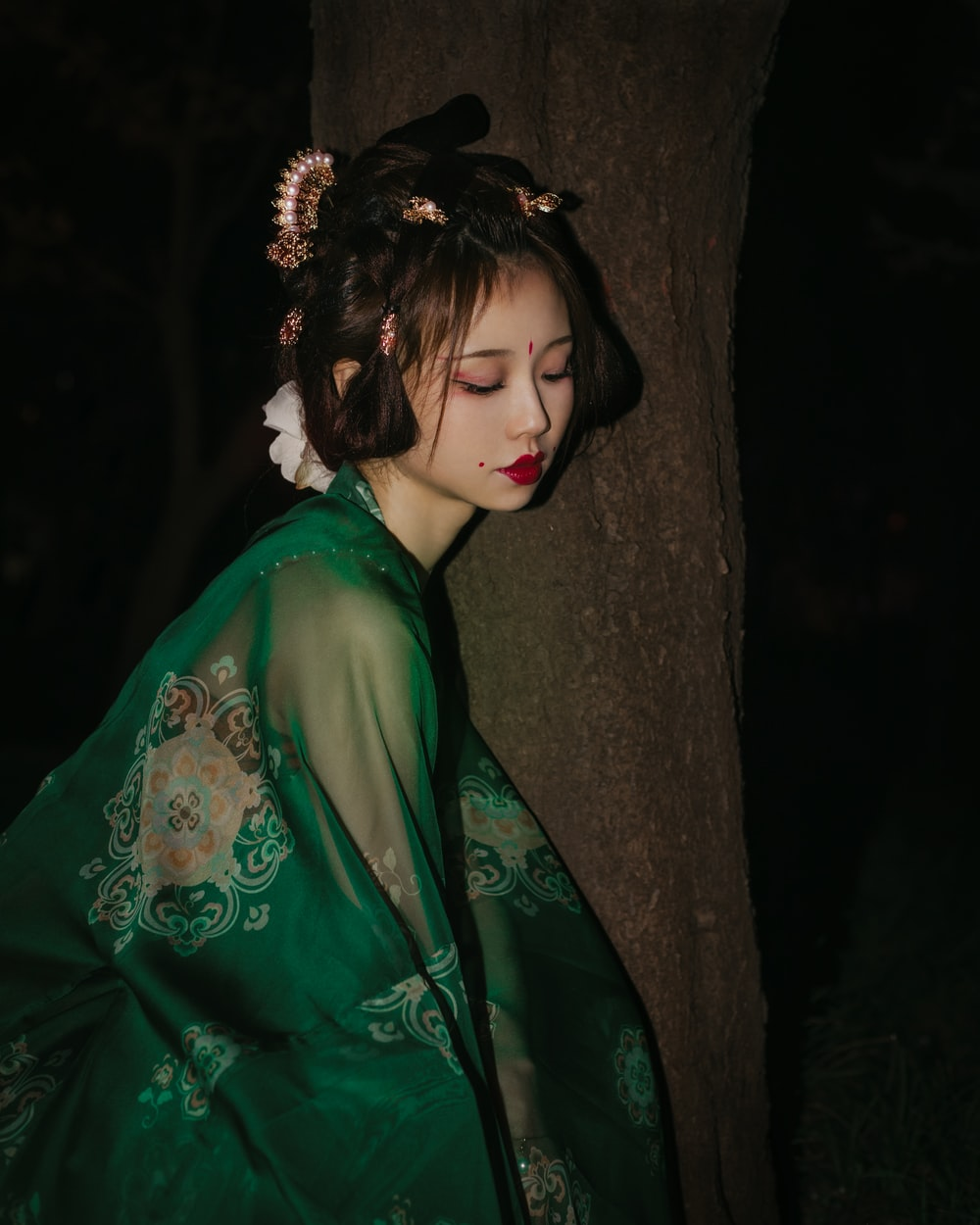 woman in green and white floral robe