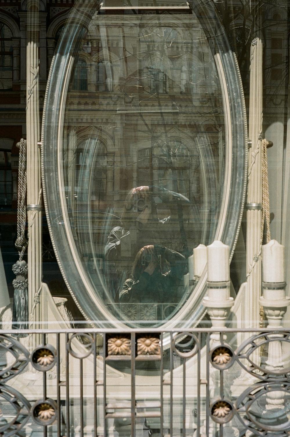 round gray framed glass mirror