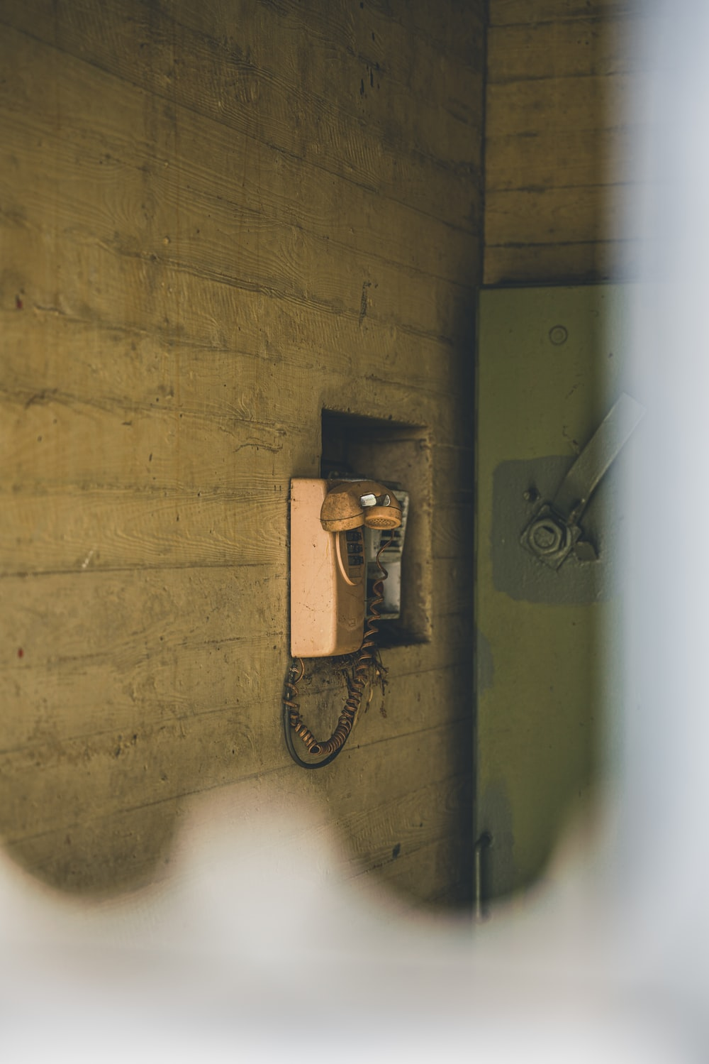 black and silver wall mounted telephone