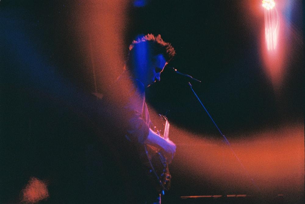 man in black suit singing