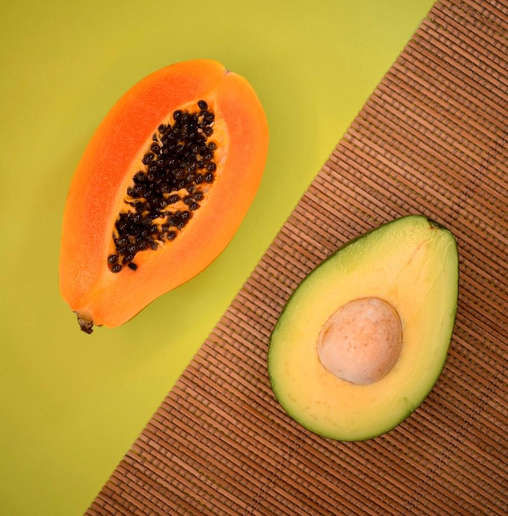 sliced avocado fruit on green plate