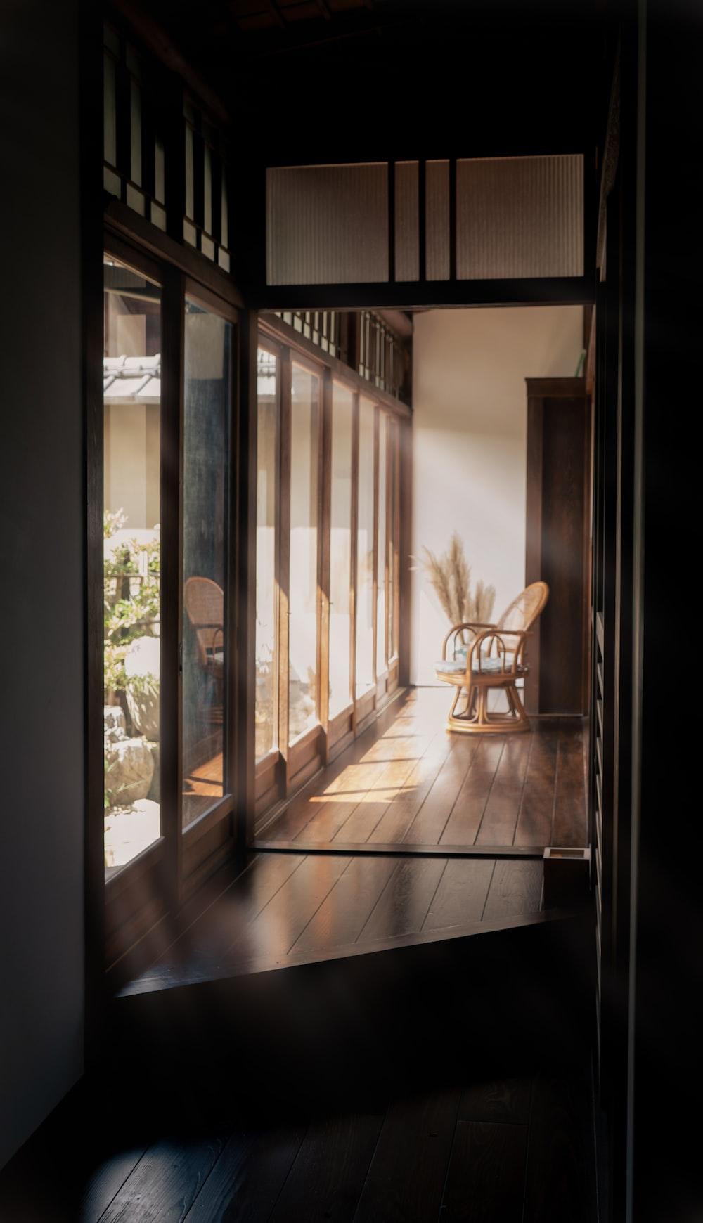 brown wooden chair near glass door