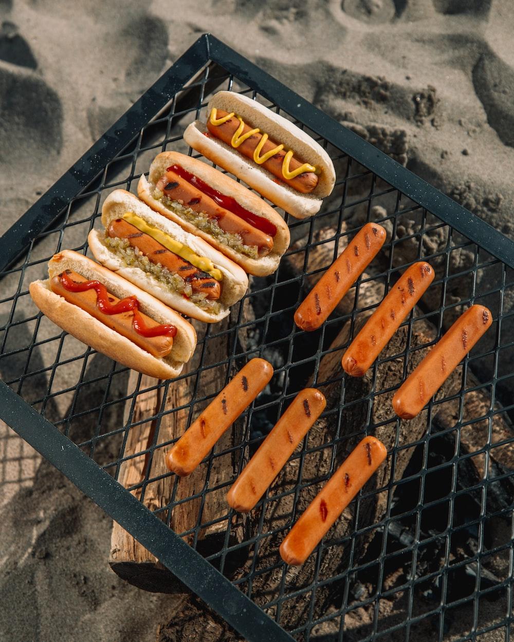 hotdog sandwich on black metal grill
