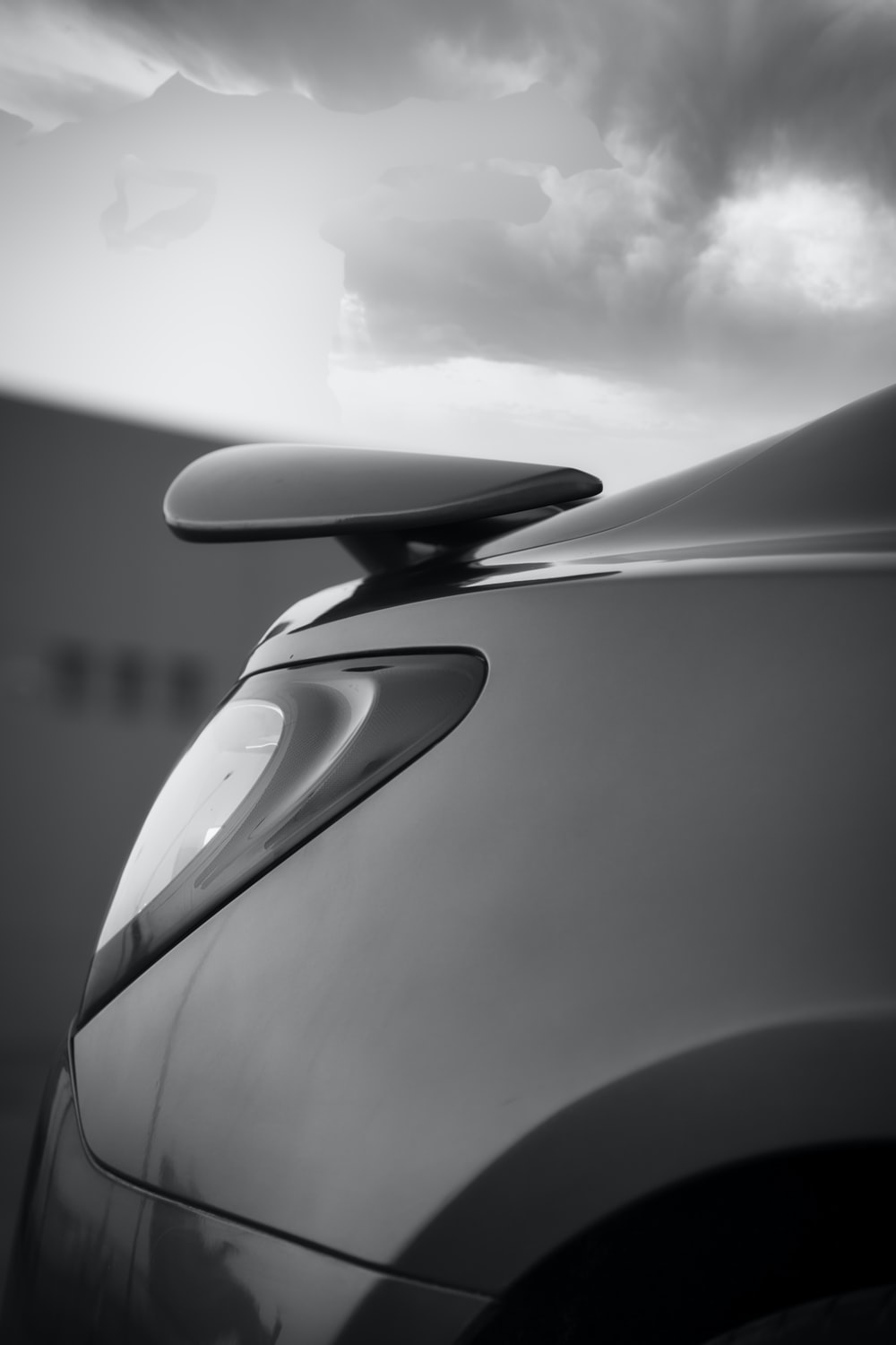 grayscale photo of cars side mirror