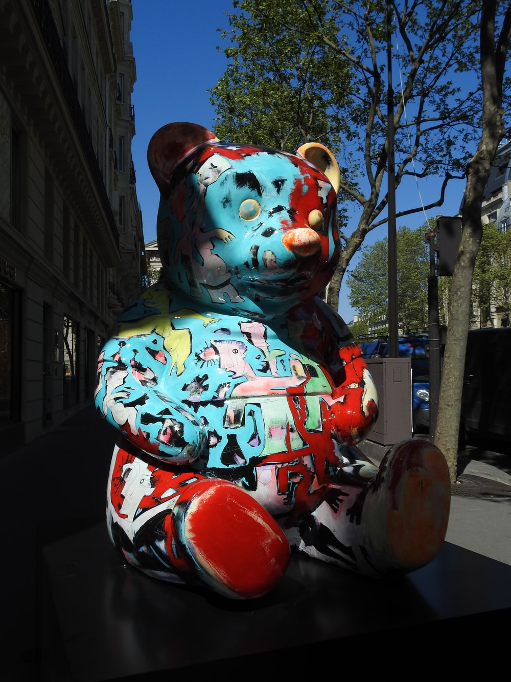 white red and blue bear statue