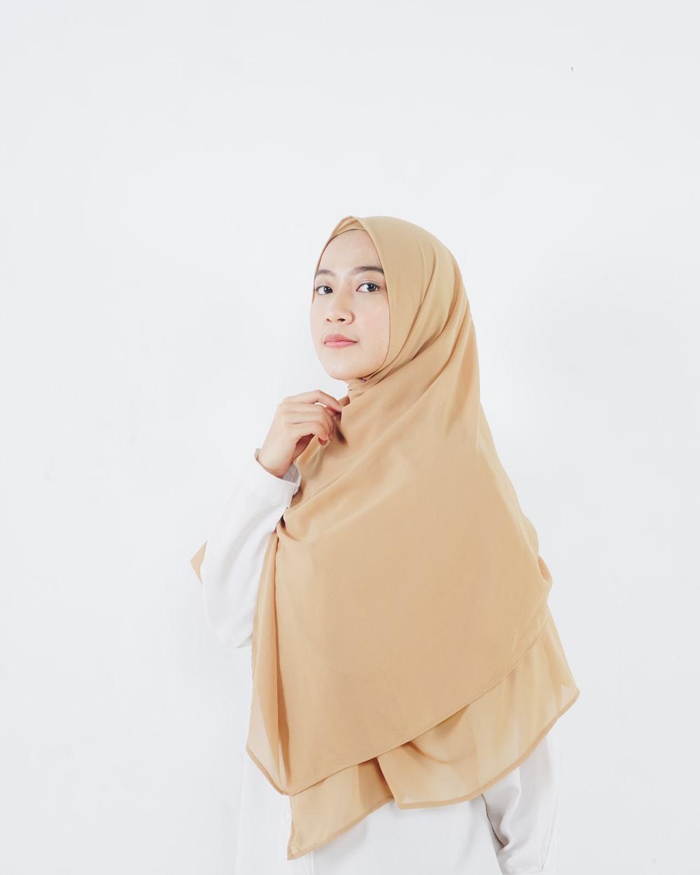 woman in beige hijab standing