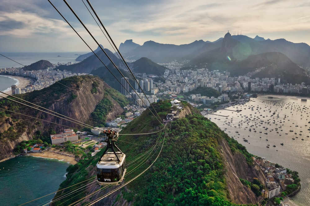 cable cars over the green grass field