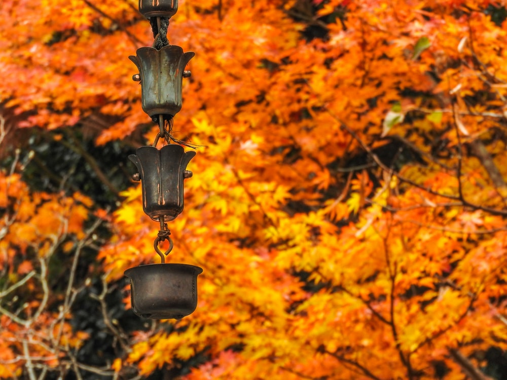 black metal candle holder with orange leaves