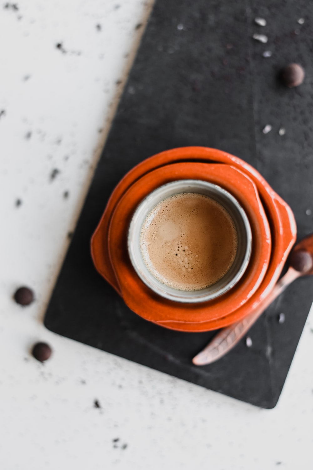 brown ceramic mug on white table