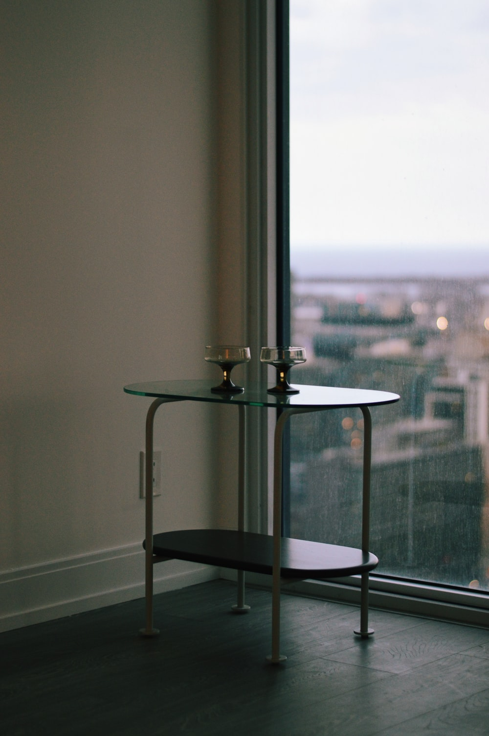 stainless steel table stand on glass table