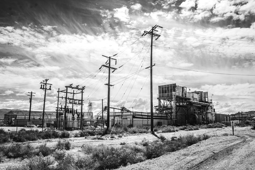 grayscale photo of electric post