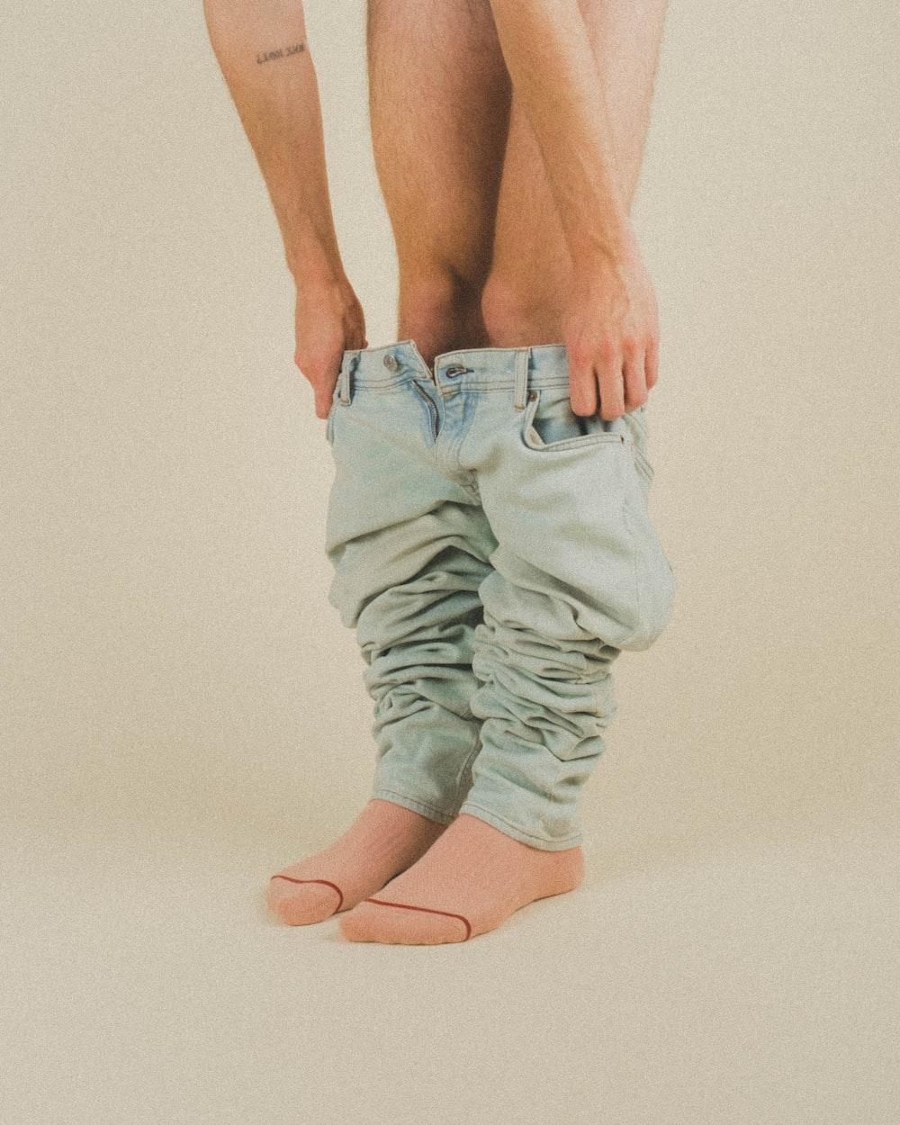 person in gray denim jeans