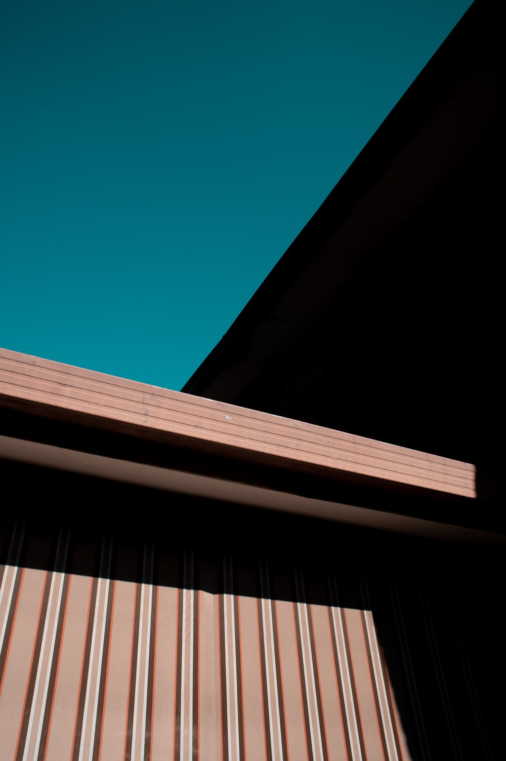 brown wooden roof under blue sky during daytime